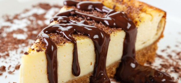 Cheesecake slice with melted and crushed chocolate